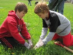 2 kids planting tree